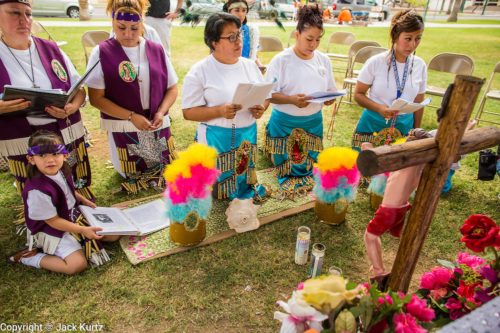 25 APRIL 2012 - PHOENIX, AZ: Opponents of SB1070 hold a prayer vigil in front of the Arizona state capitol Wednesday. Immigrants' rights groups opposed to SB1070 and Tea Party affiliated groups that support SB1070 gathered at the state capitol in Phoenix Wednesday to express their opposition and support of the bill. SB1070 was signed by Arizona Governor Jan Brewer in April 2010. At the time it was the toughest anti-illegal immigration bill in the country. Immigrants' rights groups sued Arizona and the federal courts stopped enforcement of the bill. The bill ended up in the US Supreme Court which heard arguments Wednesday. A ruling on the bill is expected in June.     PHOTO BY JACK KURTZ