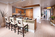 Kitchen Interior Stock Photo with Granite Countertops and Cream Colored Tile Floor