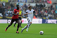 Swansea city's Jose Canas breaks away from Man Utd's Danny Welbeck. Barclays Premier league, Swansea city v Manchester Utd in Swansea, South Wales on Saturday 17th August 2013. pic by Andrew Orchard ,Andrew Orchard sports photography,