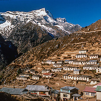 Mount Kwangde overlooks Namche Bazar, the leading town of the Sherpas and Khumbu Region of Nepal.  This was shot in 1986 as tourism was just beginning to moderneize and reshape the architecture.
