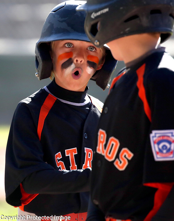 Aptos Minors All-Stars first baseman T.J. Hinds shares his joy afterscoring a run  in the district 39 Tournament of Champions at Havey West Park in Santa Cruz, California. Aptos lost the game to Capitola-Soquel.<br /> Photo by Shmuel Thaler <br /> shmuel_thaler@yahoo.com www.shmuelthaler.com