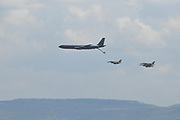Three Israeli Air force (IAF) F-16 Fighter jets being refueled by a Boeing 707 in flight