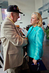 06 June 2014. The National WWII Museum, New Orleans, Lousiana. <br /> US Senator Mary Landrieu with WWII veteran Pfc Paul Madden, Company A, 379th Regiment, 95th Division, 3rd Army is honored with the French Legion of Honor medal.<br /> Photo; Charlie Varley/varleypix.com