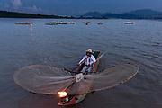 Indigenous Purépecha butterfly fisherman on Lake Patzcuaro at twilight near Janitzio Island, Michoacan, Mexico. Indigenous Purépecha butterfly fisherman on Lake Patzcuaro at twilight near Janitzio Island, Michoacan, Mexico.