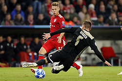 (l-r) Joshua Kimmich of FC Bayern Munchen, Maximilian Wober of Ajax during the UEFA Champions League group E match between Bayern Munich and Ajax Amsterdam at the Allianz Arena on October 02, 2018 in Munich, Germany