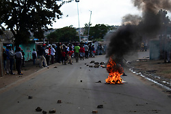 April 29, 2020, Johannesburg, Gauteng, South Africa: Protesters blocked the road by burning fires and with the stones at Diepsloot a township at the north of Johannesburg are protesting for food as residents are starving for  days because of lock down which has been implemented by the South African government for a month. (Credit Image: © Manash Das/ZUMA Wire/ZUMAPRESS.com)