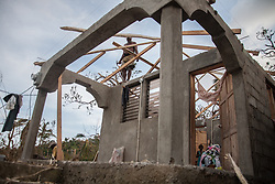 October 9, 2016 - Les Cayes, Haiti - Residents have started to repair their damaged houses in village on Tapyon near Les Cayes, Haiti, on October 9, 2016.The number of people killed in Haiti by Hurricane Matthew hit 1,000 people on Sunday, as the country battled deaths from cholera and some authorities had to start burying the dead in mass graves. (Credit Image: © Bahare Khodabande/NurPhoto via ZUMA Press)