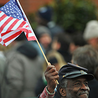 Dressed in the garb of a Union Soldier in the Civil War, a man expresses his patriotism with flag waving during a pre-inauguration rally in Wilmington, Delaware.  He was one in a crowd of thousands that braved sub-zero temperatures to lend support.   Obama, Vice President-elect Biden and their families traveled by train on a Whistle Stop Tour, opening Inauguration celebrations with rallies in Philadelphia, Wilmington, and Baltimore before their final arrival in Washington, D.C.  The inauguration takes place on January 20, 2009, swearing Obama in as the 44th President of the United States of America.¬?
