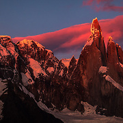 First light touches the infamous Cerro Torre on the border of Chile and Argentina, Patagonia.