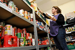 © Licensed to London News Pictures. 12/12/2013; Bristol, UK.  Volunteer Anna sorts food donations and distribution at Bristol North West Food Bank distribution point at Lawrence Weston Baptist Church.  A wide range of people use the service, both those on benefits and those in work, and from a wide range of backgrounds.  Ffi: bristolnwfoodbank.org.uk  12 December 2013.<br /> Photo credit : Simon Chapman/LNP