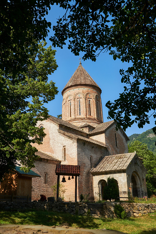 """Pictures & imagse of Timotesubani medieval Orthodox monastery Church of the Holy Dormition (Assumption), dedcated to the Virgin Mary, 1184-1213, Samtskhe-Javakheti region, Georgia (country).<br /> <br /> Built during the reigh of Queen Tamar during the """"Golden Age of Georgia"""", Timotesubani Church of the Holy Dormition is one of the most important examples of medieval Georgian architecture and art. <br /> <br /> Built of pinkish Georgian brick to a cruciform floor plan. The eastern end of the church has 3 apses. Above the centre of the church is a high Georgian style cupola supported on 2 columns. .<br /> <br /> Visit our MEDIEVAL PHOTO COLLECTIONS for more   photos  to download or buy as prints https://funkystock.photoshelter.com/gallery-collection/Medieval-Middle-Ages-Historic-Places-Arcaeological-Sites-Pictures-Images-of/C0000B5ZA54_WD0s<br /> <br /> Visit our REPUBLIC of GEORGIA HISTORIC PLACES PHOTO COLLECTIONS for more photos to browse, download or buy as wall art prints https://funkystock.photoshelter.com/gallery-collection/Pictures-Images-of-Georgia-Country-Historic-Landmark-Places-Museum-Antiquities/C0000c1oD9eVkh9c"""