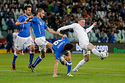 Wayne Rooney of England is challenged by Alessandro Florenzi of Italy - Photo mandatory by-line: Rogan Thomson/JMP - 07966 386802 - 31/03/2015 - SPORT - FOOTBALL - Turin, Italy - Juventus Stadium - Italy v England - FIFA International Friendly Match.