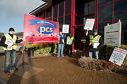 PCS members and supporters in Sheffield stage an eight-hour demonstration to protest  against the planned closure of the local office of the Driver and Vehicle Licensing Agency (DVLA). The protest was called to coincide with a visit to the premises by transport minister Mike Penning.on Monday (23 January) but according to Mike Mackie, assistant secretary of the PCS northern branch for the DVLA, the visit was canceled within 15 minutes of the Sheffield Demo being announced on the PCS website..left to right Mark Devlin Mike Mackie, Shajahn Miah and Luke Brown..www.pauldaviddrabble.co.uk..23 January 2012 -  Image © Paul David Drabble