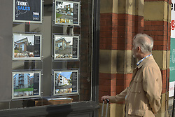October 19, 2016 - Manchester, England, United Kingdom - A person looks at a selection of property adverts displayed in a window on October 19, 2016 in Manchester, England. The United Kingdom's finance industry regulator, the Financial Conduct Authority, has announced a commitment to consult on mortgage payment shortfall remediation guidance. (Credit Image: © Jonathan Nicholson/NurPhoto via ZUMA Press)