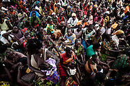 Internally displaced people from Zangia, which was attacked by the LRA last week, gather in Tembura to recieve shelter items from IOM. A recent flurry of LRA attacks in South Sudan has pushed thousands of familes to flee from their remote homes to larger towns and roadsides.