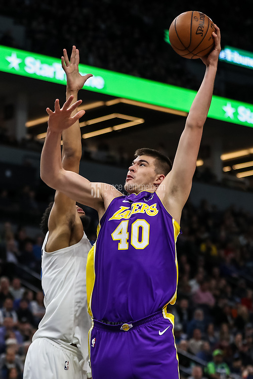 Feb 15, 2018; Minneapolis, MN, USA; Los Angeles Lakers center Ivica Zubac (40) shoots over Minnesota Timberwolves center Karl-Anthony Towns (32) during the second quarter at Target Center. Mandatory Credit: Brace Hemmelgarn-USA TODAY Sports