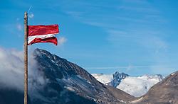THEMENBILD - die Österreichische Fahne weht im Wind. Die Grossglockner Hochalpenstrasse verbindet die beiden Bundeslaender Salzburg und Kaernten mit einer Laenge von 48 Kilometer und ist als Erlebnisstrasse vorrangig von touristischer Bedeutung, aufgenommen am 15. September 2016, Bruck a. d. Glocknerstrasse, Oesterreich // the Austrian flag waving in the wind. The Grossglockner High Alpine Road connects the two provinces of Salzburg and Carinthia with a length of 48 km and is as an adventure road priority of tourist interest at Bruck a. d. Glocknerstrasse, Austria on 2016/09/15. EXPA Pictures © 2016, PhotoCredit: EXPA/ JFK