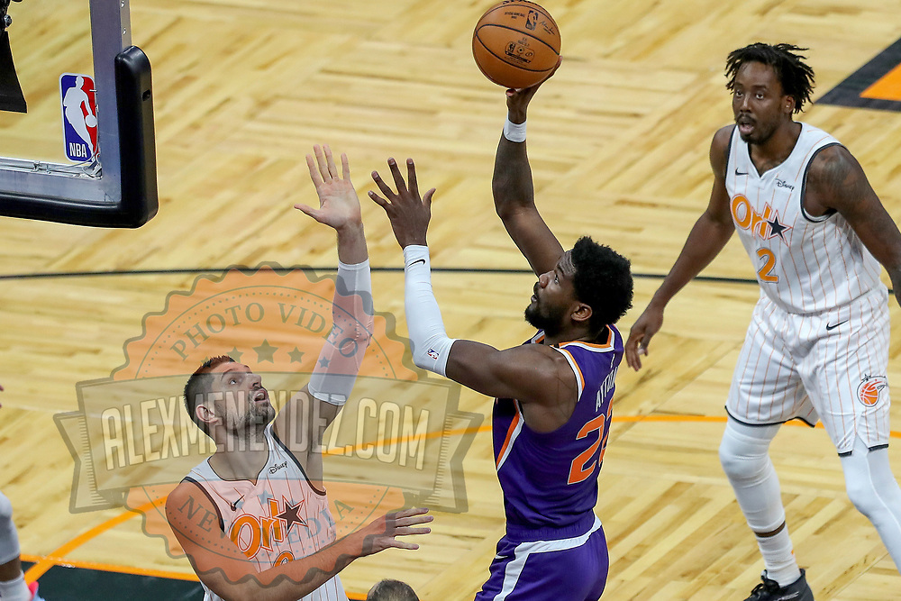 ORLANDO, FL - MARCH 24: Deandre Ayton #22 of the Phoenix Suns attempts a shot over Nikola Vucevic #9 of the Orlando Magic as Al-Farouq Aminu #2 of the Orlando Magic looks on during the first half at Amway Center on March 24, 2021 in Orlando, Florida. NOTE TO USER: User expressly acknowledges and agrees that, by downloading and or using this photograph, User is consenting to the terms and conditions of the Getty Images License Agreement. (Photo by Alex Menendez/Getty Images)*** Local Caption *** Deandre Ayton; Nikola Vucevic; Al-Farouq Aminu