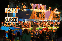 12 Feb 2015. New Orleans, Louisiana.<br /> Mardi Gras. The Rights of Passage, Road Block float makes its way along Magazine Street  with the The Krewe of Muses. <br /> Photo; Charlie Varley/varleypix.com