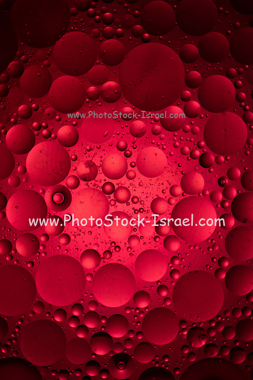 Close up of a Red 'moon craters' ball on black