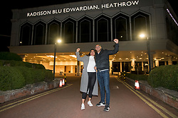 © Licensed to London News Pictures. 26/02/2021. London, UK. Brazilian couple Wagner and Elaine Araujo celebrate as they leave the Radisson hotel near Heathrow Airport after their quarantine period ended. New quarantine measures were introduced for travellers form red list countries, who are required to isolate for ten days in a hotel at a cost of £1,750 per person. Photo credit: Ben Cawthra/LNP