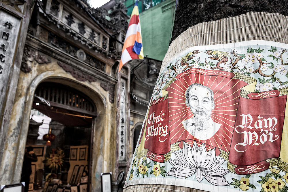 A celebratory New Year sign hangs ouside a pagoda along Hang Ma Street in Hanoi's Old Quarter, Vietnam, Southeast Asia
