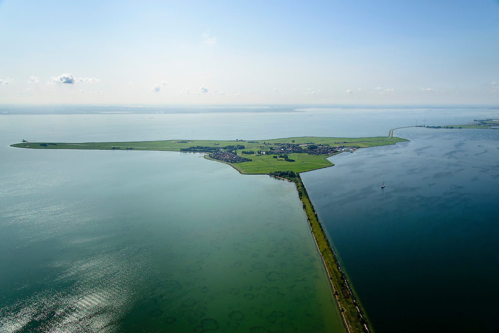 Nederland, Noord-Holland, Marken, 05-08-2014;  het voormalig eiland Marken, nu met een dam verbonden met Waterland. met de bijnaam Paard van Marken. Het omliggende water is het Markermeer (IJsselmeer, Zuiderzee).<br /> The former island of Marken, now connected with a causeway (dam) to the mainland. <br /> luchtfoto (toeslag op standard tarieven);<br /> aerial photo (additional fee required);<br /> copyright foto/photo Siebe Swart