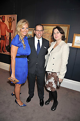 Left to right, ELENA MAKRI LIBERIS, JONATHAN NEWHOUSE and ALEXANDRA SHULMAN at a party to celebrate the publication of Elena Makri Liberis's book 'Every Month, Same day' held at Sotheby's, 34-35 New Bond Street, London on 5th May 2009.
