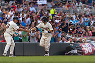 Brian Dozier #2 of the Minnesota Twins is congratulated by 3rd base coach Joe Vavra #46 after hitting a home run against the Chicago White Sox on June 19, 2013 at Target Field in Minneapolis, Minnesota.  The Twins defeated the White Sox 7 to 4.  Photo: Ben Krause