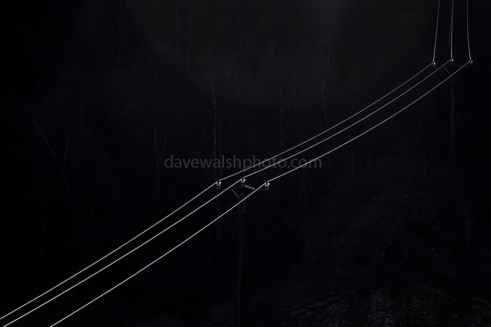 """Sunlight falls on electrical transmission cables in a valley near the village of Py, in the Eastern Pyrenees, France.  Abstract ideas - electrical energy is synonymous with lighting homes; in this case, solar energy is falling on electrical cables containing a current probably generated by non-renewable means. This mage can be licensed via Millennium Images. Contact me for more details, or email mail@milim.com For prints, contact me, or click """"add to cart"""" to some standard print options."""