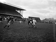31/01/1959<br /> 01/31/1959<br /> 31 January 1959<br /> Final Irish Rugby International Trial at Lansdowne Road, Dublin. M.A. English, (Bohemians) Whites stand off half, tries to get the ball away (With assistance of his tongue out) before two blues forwards arrive on the scene. He succeeded.