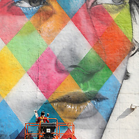 MINNEAPOLIS, MN - AUGUST 28:  Brazilian artist Eduardo Kobra and his team paint a 60 foot by 150 foot mural of musician Bob Dylan on the side of a building on August 28, 2015 in Minneapolis, Minnesota.  (Photo by Adam Bettcher/Getty Images) *** LOCAL CAPTION *** Eduardo Kobra