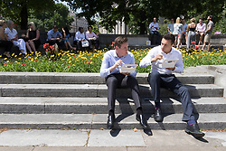 © Licensed to London News Pictures. 07/07/2017. LONDON, UK.  Office workers and tourists picnic at lunchtime near St Paul's Cathedral in London during hot and sunny weather today.  Photo credit: Vickie Flores/LNP