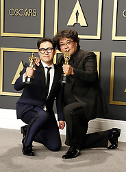 Han Jin-won and Bong Joon-ho at the 92nd Academy Awards - Press Room held at the Dolby Theatre in Hollywood, USA on February 9, 2020.