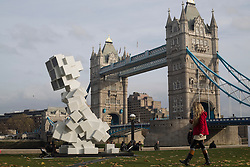 © licensed to London News Pictures. London, UK 19/11/2012. Five-metre tall sculpture of a man squatting, entitled The Public Toile by Andrew Shoben, is installed in Potters Field Park as part of World Toilet Day, which focuses on improving lavatory hygiene in both the developed and developing economies of the world. Photo credit: Tolga Akmen/LNP