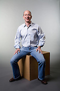 Jeff Bezos CEO Amazon.com Jeff Bezos, CEO of Amazon.com.  Photographed in studio setting for Businessweek Magazine, 2006-10. Sitting on large cardboard box.
