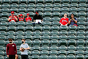 ANAHEIM, CALIFORNIA - APRIL 01: Fans look on from the outfield before the game between the Los Angeles Angels and the Chicago White Sox on Opening Day at Angel Stadium of Anaheim on April 01, 2021 in Anaheim, California. This is the first time that fans have been allowed to attend a game at Angel Stadium of Anaheim since its closing due to the coronavirus pandemic. (Photo by Katelyn Mulcahy/Getty Images)