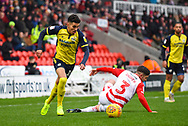 Yasin Ben El-Mhanni of Scunthorpe United (19) squirms past Danny Andrew of Doncaster Rovers (3) during the EFL Sky Bet League 1 match between Doncaster Rovers and Scunthorpe United at the Keepmoat Stadium, Doncaster, England on 15 December 2018.