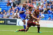 Frederic Gounongbe  of Cardiff city (l) has a shot at goal blocked by Steven Caulker of Queens Park Rangers.  EFL Skybet championship match, Cardiff city v Queens Park Rangers at the Cardiff city stadium in Cardiff, South Wales on Sunday 14th August 2016.<br /> pic by Andrew Orchard, Andrew Orchard sports photography.