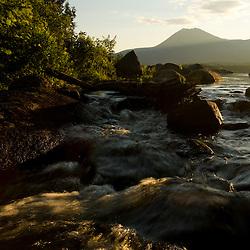 Katahdin Lake as it tumbles into Katahdin Brook near Maine's Baxter State Park.  Mount Katahdin is in the distance.