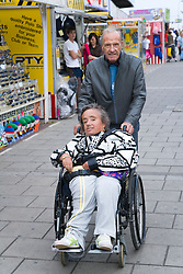 Woman with Spina Bifida and her father who is her carer on a day trip to Skegness organised by the Nottingham Disabled Friendship Club,