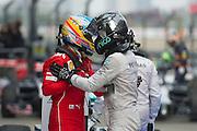 April 20, 2014 - Shanghai, China. UBS Chinese Formula One Grand Prix. Fernando Alonso (SPA), Ferrari, Nico Rosberg  (GER), Mercedes Petronas