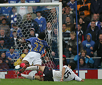 Photo: Lee Earle.<br /> Portsmouth v Bolton Wanderers. The FA Barclays Premiership. 18/08/2007.Bolton's Gerald Cid (R) brings down Kanu to concede a penalty.