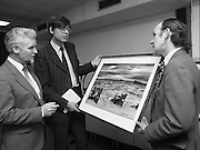Tory Island Painters Exhibition.1985..05.03.1985..03.05.1985.5th March 1985..At Bord na Gaeilge Headquarters,Dublin an exhibition of painting was held to celebrate the work of Tory Island Painters. In attendance was the Minister for Finance Mr Alan Dukes T.D...Picture shows Mr Dukes admiring the work of artist Mr Patsy Dan Mac Ruaidhri (right). Also pictured is Mr Michael Grae, Chief Executive,Bord na Gaeilge.