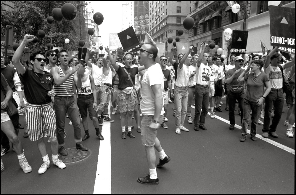 """Alan Klein, Donna Minkowitz, Adam Rolston, Jason Hefner, John Davis and others of ACT UP NY, on June 24, 1989, the 20th anniversary of the Stonewall riots, participating in a renegade march up 6th avenue to Central Park. Themed, """"In The Tradition"""", this march followed the same route as the original march 20 years ago and was designed as a rebuke to the corporatization of the gay pride parade."""