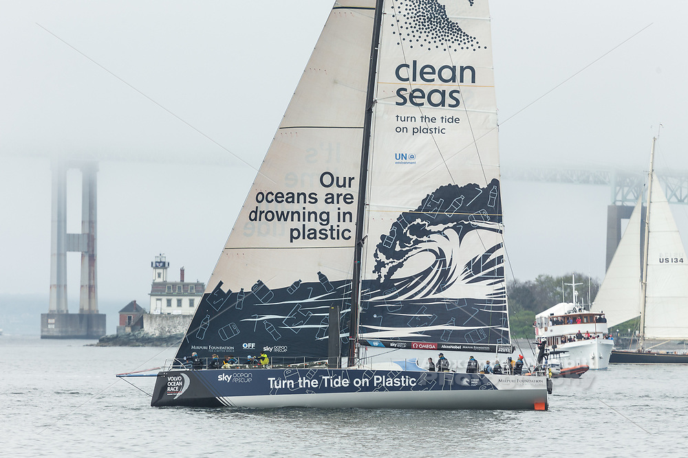 In the Volvo Race stop over ProAm race TTOP passes by a fog shrouded Newport Bridge and Rose Island Lighthouse