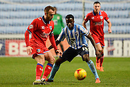 Coventry City midfielder Gael Bigirimana watches Oldham Athletic midfielder Liam Kelly during the Sky Bet League 1 match between Coventry City and Oldham Athletic at the Ricoh Arena, Coventry, England on 19 December 2015. Photo by Alan Franklin.