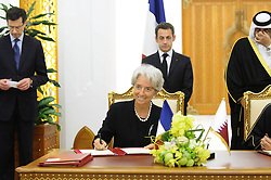 File Photo - Minister Christine Lagarde signs a deal with Qatar, as the Emir Sheikh Hamad Bin Khalifa Al Thani receives President Nicolas Sarkozy at the Emiri Palace in Doha, Qatar, on January 14, 2008, on the second day of his visit to the Arabian Gulf area. France signed with Qatar nuclear and electricity agreements. The European Council announced Tuesday that Lagarde, the current head of the International Monetary Fund, had been chosen to succeed Mario Draghi as president of the European Central Bank,, whose eight-year term ends in October. Photo by Ammar Abd Rabbo/ABACAPRESS.COM