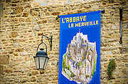 Banner and street lamp, Mont Saint-Michel, Normandy, France