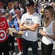 Acotr Josh Duhamel (center) and Rosie Huntington-Whiteley speak with crew members in the Sprint Cup garage area prior to the Daytona 500 at Daytona International Speedway.at Daytona International Speedway on February 20, 2011 in Daytona Beach, Florida. (AP Photo/Alex Menendez)